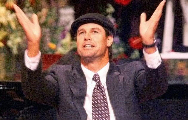 PGA golfer Paul Azinger gestures as he eulogizes his friend and former golfer Payne Stewart at the First Baptist Church in Orlando, Fla., on Friday, Oct. 29, 1999. Stewart, along with five others, was killed in a private plane crash last Monday in South Dakota.  (AP Photo/Joe Burbank, POOL) ORG XMIT: FLORL121 [Via MerlinFTP Drop]